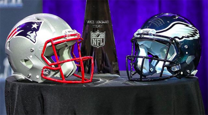New England Patriots and Philadelphia Eagles helmets next to the Lombardi trophy