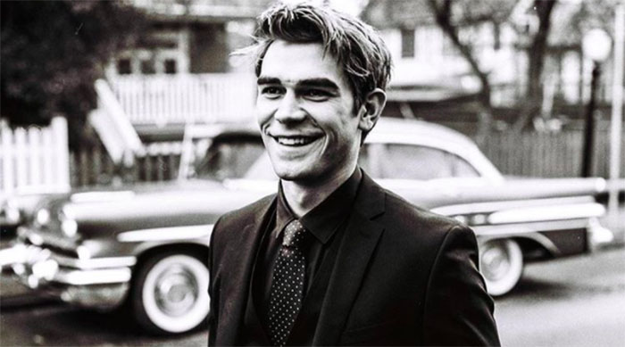 KJ Apa black and white tux photo