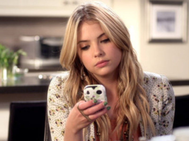 Hanna Looking at Her Phone