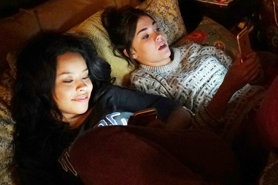 Callie and Mariana texting in bed