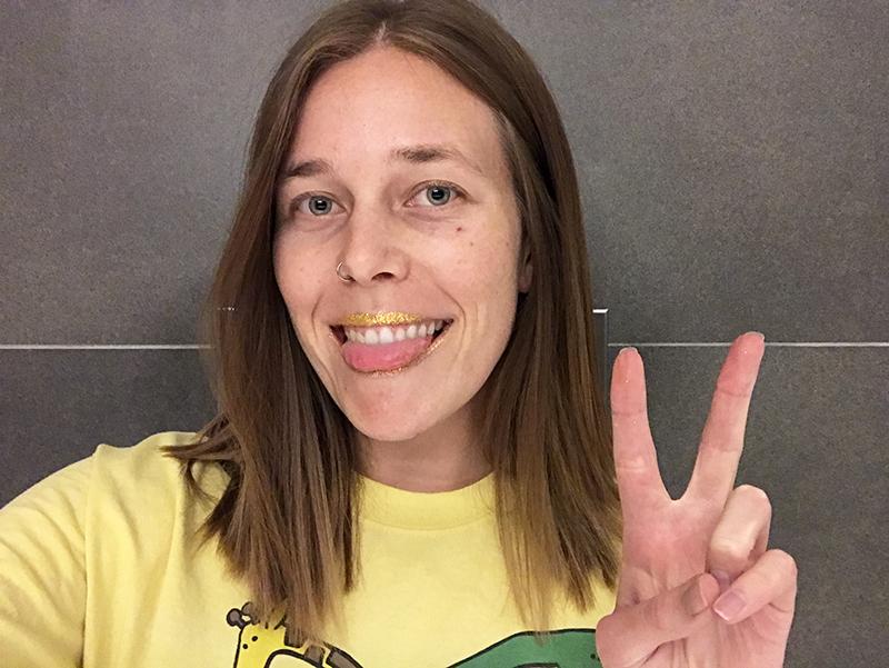 Ashley wearing yellow glitter on her lips