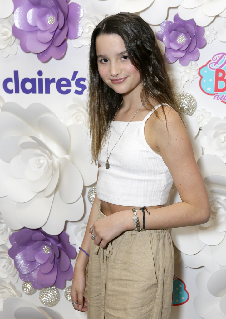 Annie LeBlanc stops by the purple carpet at the intimate awards ceremony.