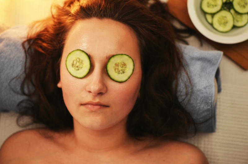 Girl With Cucumbers Over Eyes