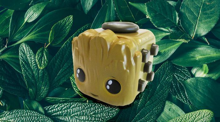 Baby groot fidget cube on leaves backgrounc