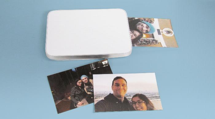 Lifeprint printer printing out photos