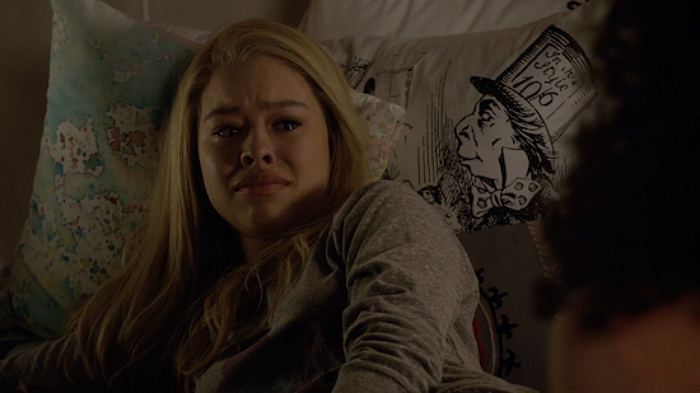 Mariana crying in bed