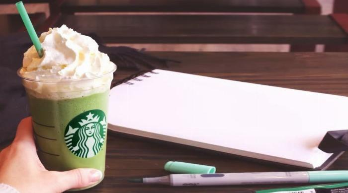 Matcha Green Tea frap with pens and paper