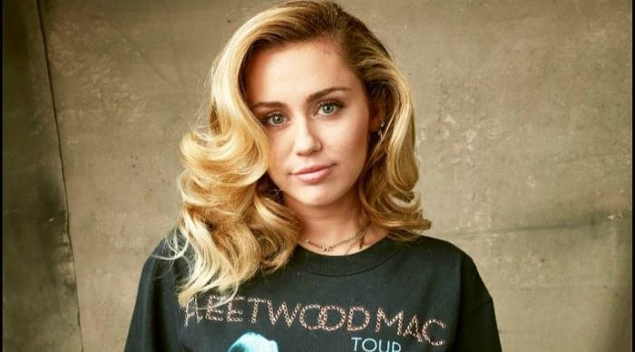 Miley Cyrus in a Fleetwood Mac Shirt