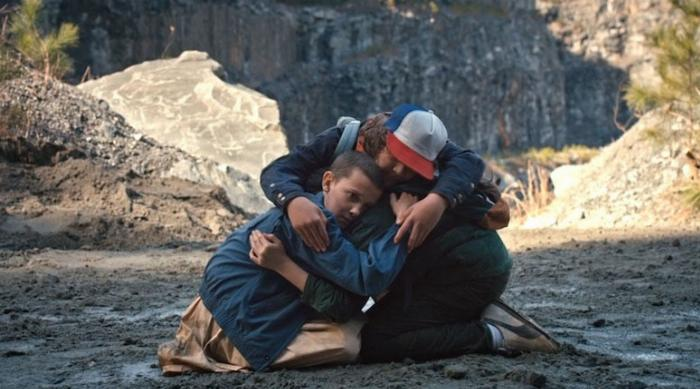 Stranger Things: Eleven, Dustin and Mike hug after dealing with bullies
