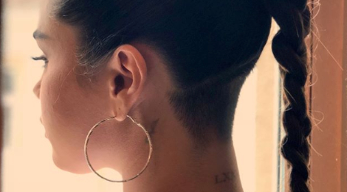 Selena Gomez with gold hoop earrings