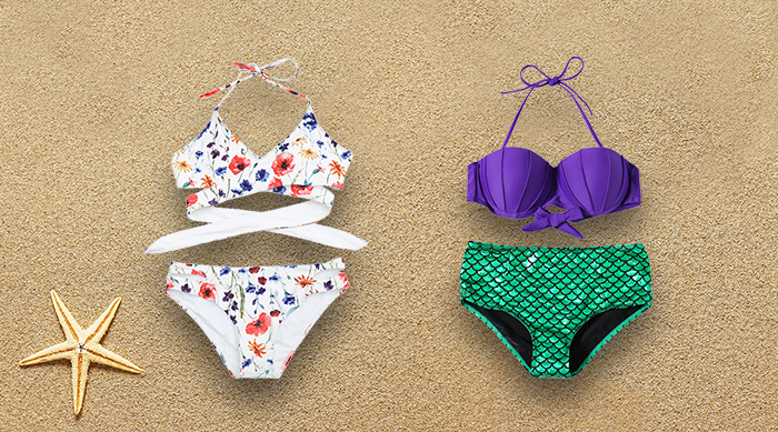 Summer bathing suits on sand