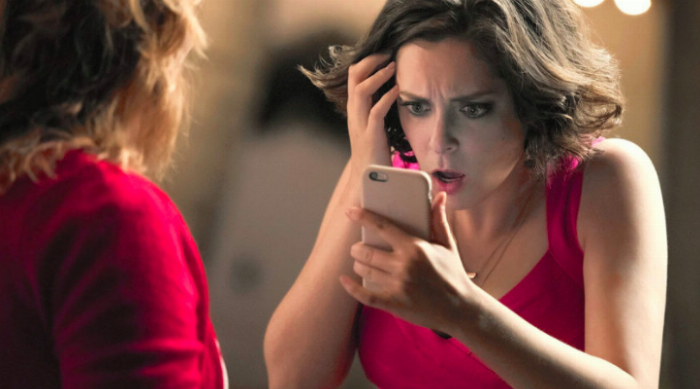 Crazy Ex-Girlfriend Looking at Phone Horrified