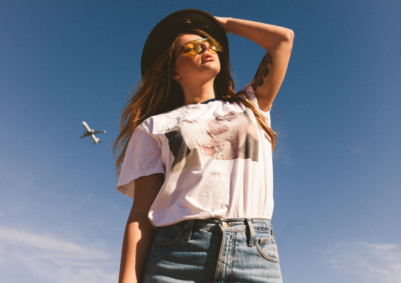 Trendy Girl With Sky in Background