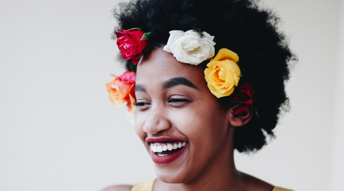 girl with flower crown smiling