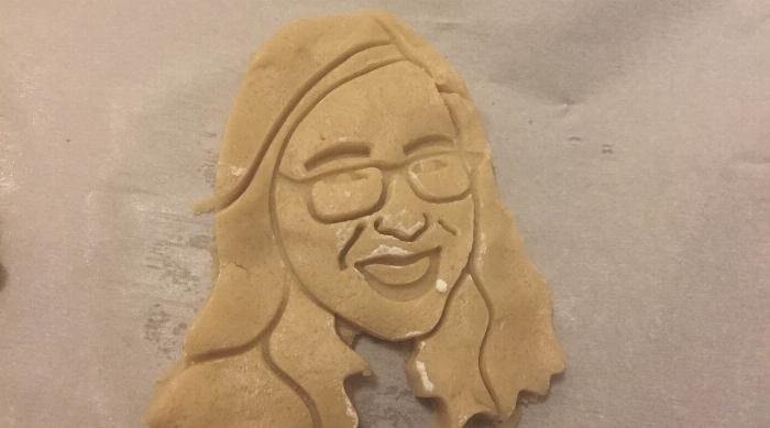 Cookie dough after cookie cutter shaped like Amanda McArthur's face