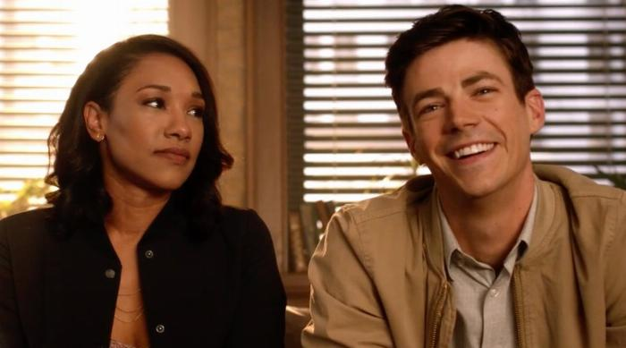 Iris looking concerned at Barry while he's smiling during a couple's therapy session on The Flash