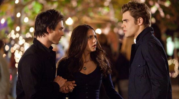 Damon, Elena and Stefan looking confused in an episode of The Vampire Diaries
