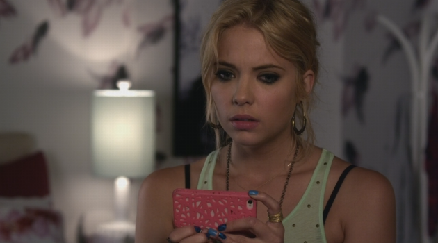 Hanna looking nervously at her phone on an episode of Pretty Little Liars