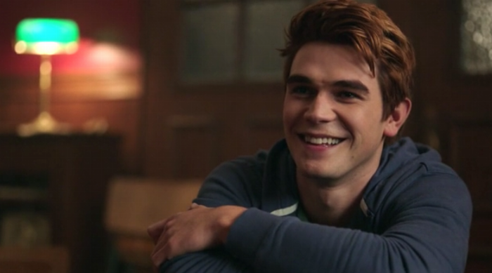 Riverdale: Archie smiling and crossing his arms