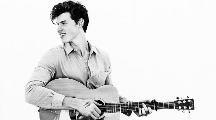 Shawn Mendes with a guitar