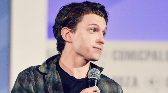 Tom Holland with a microphone