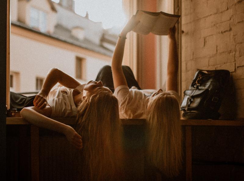 Girls reading book