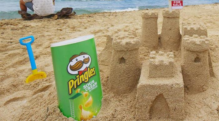 Pringles Sour Cream and Onion can in the sand at a beach
