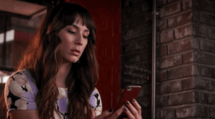 Pretty Little Liars: Spencer staring at her phone