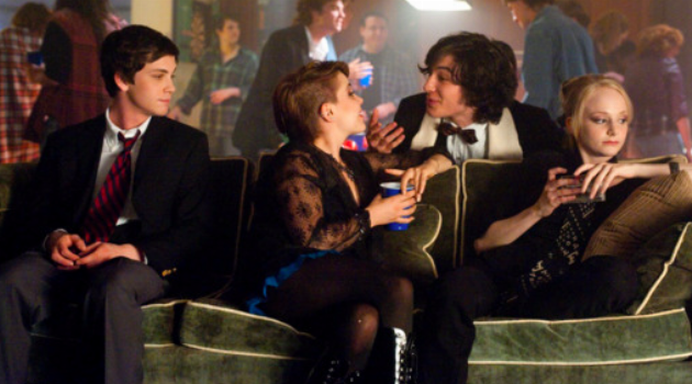 The Perks of Being a Wallflower: Charlie sits with his friends on the couch at a party