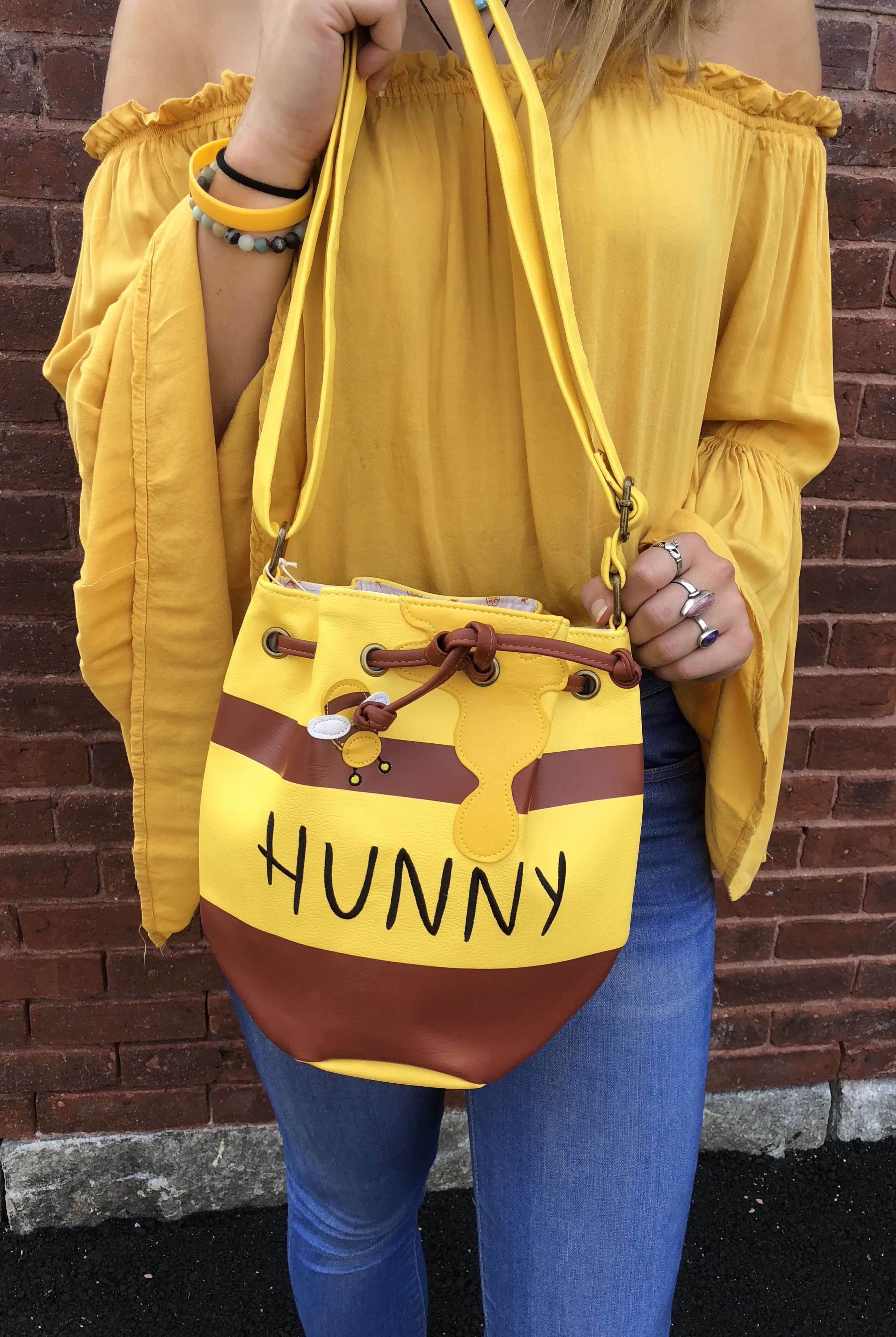 e8ff8133eed5 This Winnie The Pooh Honey Pot Bag Is Too Cute for Words