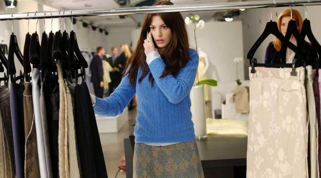 Andy looking at clothes in The Devil Wears Prada