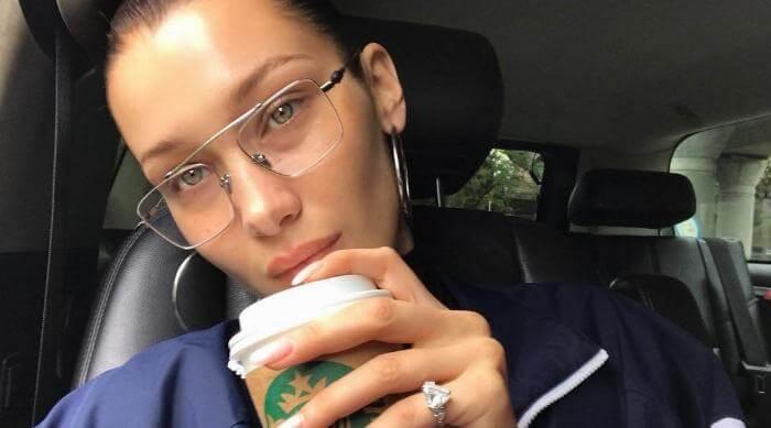 Instagram: Bella Hadid wearing glasses and drinking Starbucks