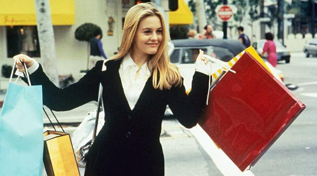 Cher holding shopping bags on Rodeo Drive in Clueless