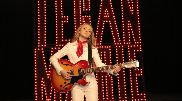 Tegan Marie holding a guitar