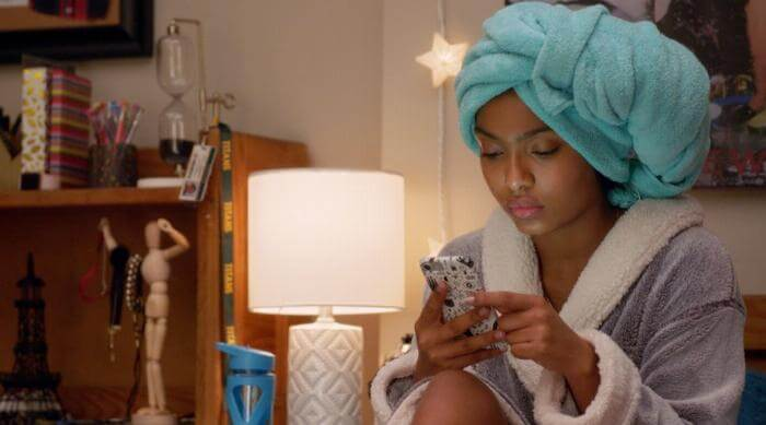 Grown-ish: Zoey texting while wearing a towel turban