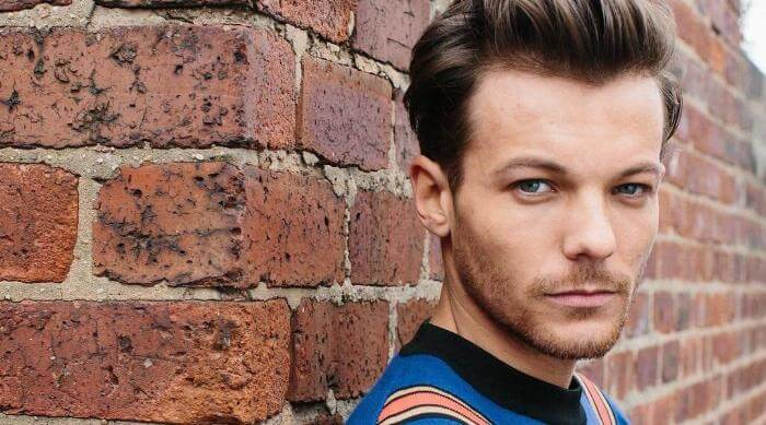 Louis Tomlinson Wears a Blue Sweater