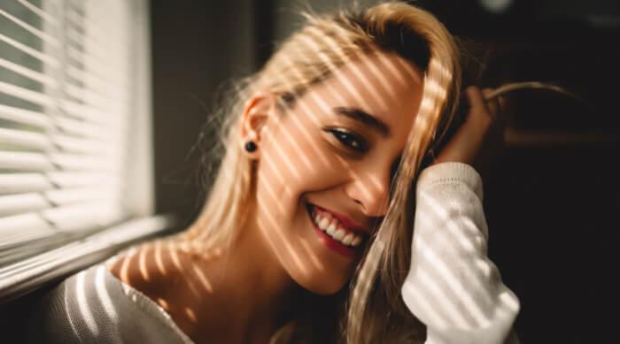 Blonde girl smiling
