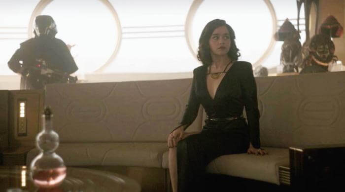 Solo: A Star Wars Story: Qi'ra sitting on yacht couch