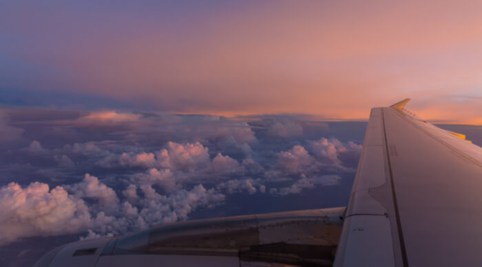 View of airplane wing over the clouds
