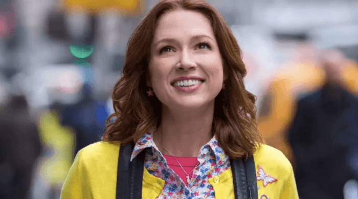 Unbreakable Kimmy Schmidt: Kimmy wearing yellow sweater and backpack