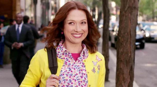 Kimmy smiling while walking down the street in Unbreakable Kimmy Schmidt