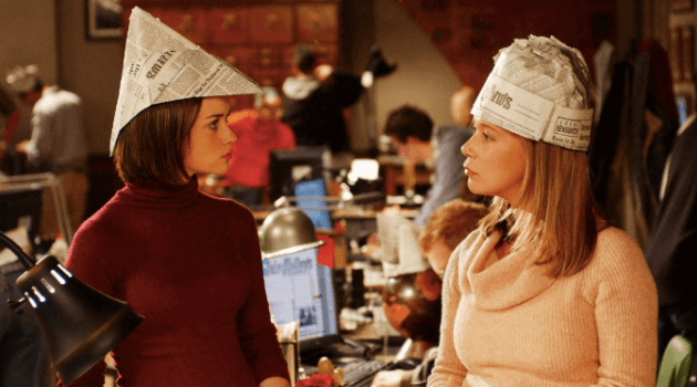 Gilmore Girls: Paris and Rory wearing paper hats