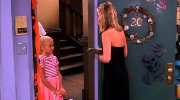 Rachel passing out candy on Halloween on an episode of Friends