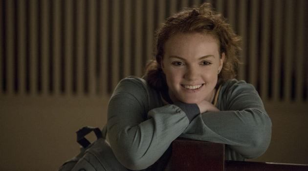 Sierra smiling while sitting on a chair in Sierra Burgess Is a Loser