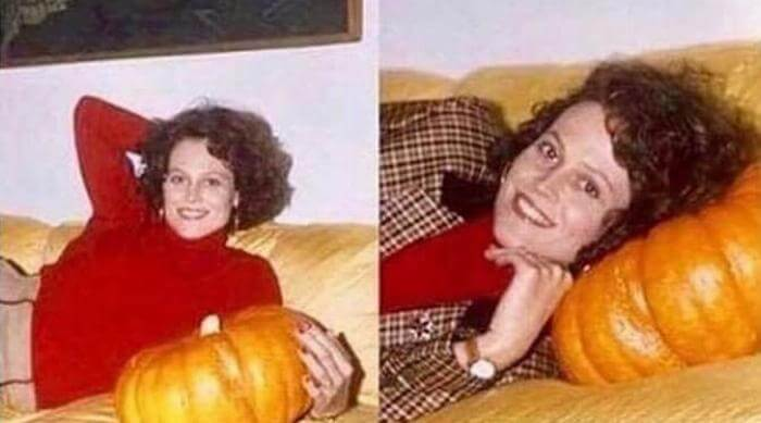 Woman laying with pumpkin