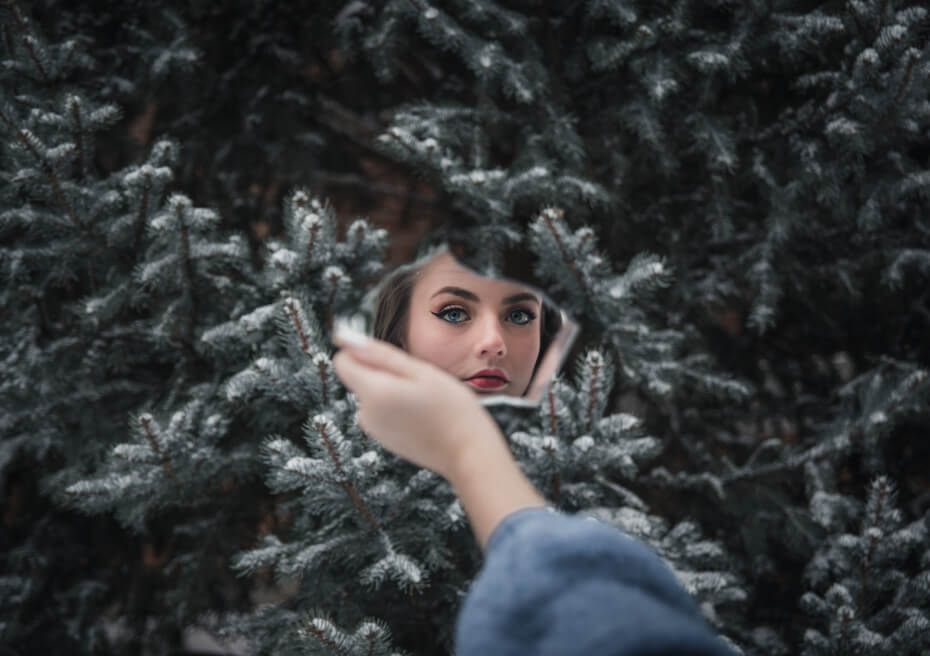 girl in makeup against holiday backdrop