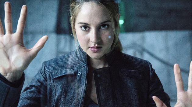 divergent-tris-hands-against-glass-articleH-112718