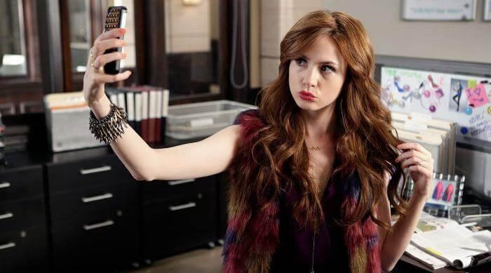 Karen Gillan taking a selfie in ABC's Selfie