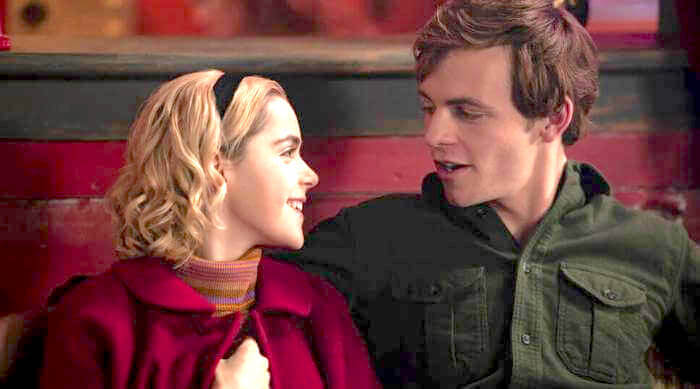 Sabrina smiling at Harvey while cuddling in The Chilling Adventures of Sabrina