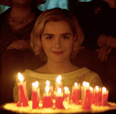 sabrina-smiling-behind-birthday-candles